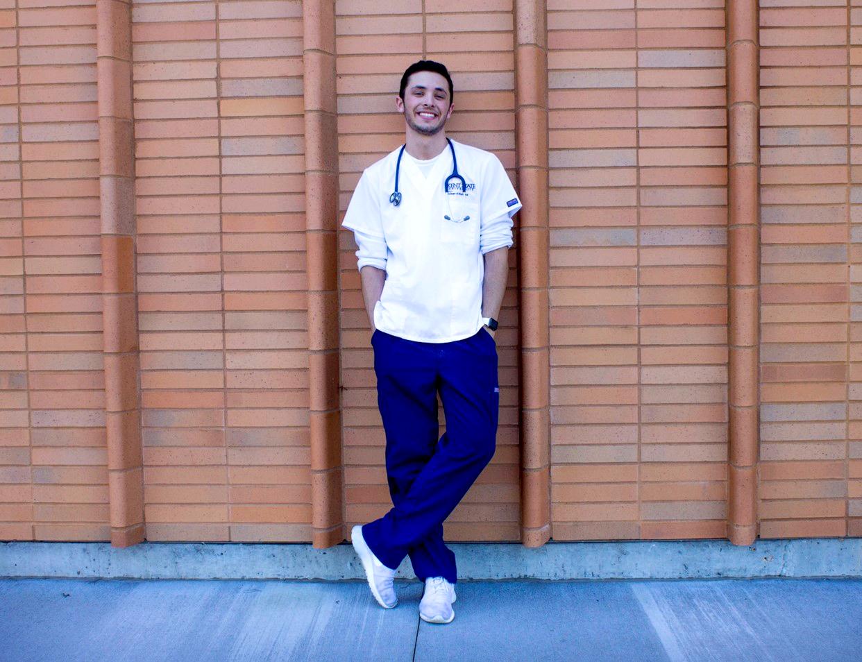 Healthcare worker in scrubs